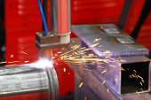 picture of pipe-welding  - Automated plasma welding machine and pipes with sparks - JPG
