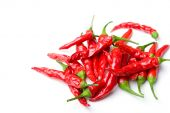 Bunch of small red spicy hot chili peppers close up isolated poster