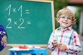 Cute Child At Blackboard Practicing Mathematics poster
