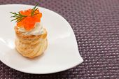 stock photo of cream puff  - Puff pastry with cream cheese and caviar - JPG