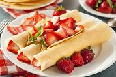 image of crepes  - Fresh Strawberry French Crepes with Mint for Breakfast - JPG