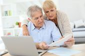foto of income tax  - Senior couple doing the income tax declaration online - JPG