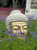 stock photo of garden eden  - Head of statue in Buddha Eden Garden - JPG