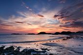 stock photo of bute  - Colorful sunset on the beach of Traigh Mor Isle of Iona Inner Hebrides of Scotland - JPG