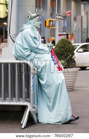 Only in New York. Unidentified street performer dressed as a Statue of Liberty at Times Square