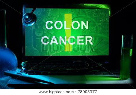 Notebook with words colon cancer