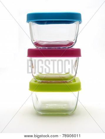 Set of glass lidded tubs