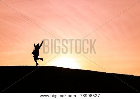 Woman Dancing Against A Setting Sun