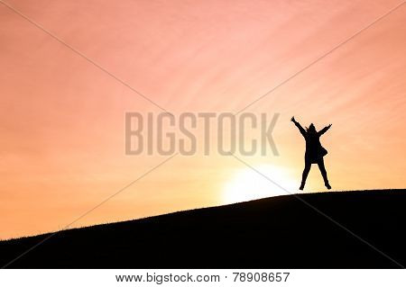 Woman Jumping Up In The Air