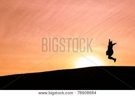 Happy Woman Jumping Up In The Air