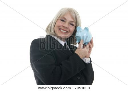 Cute Business Woman Holding A Piggy Bank