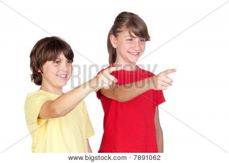 Adorable Preteen Girl And Little Boy Finger Pointing