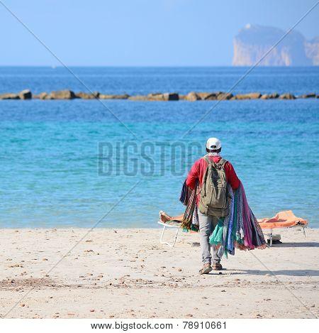 Seller Walking On The Beach In Alghero Shore