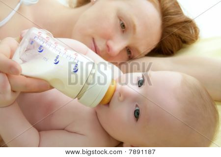 Baby Drinking Bottle From Mother Hands