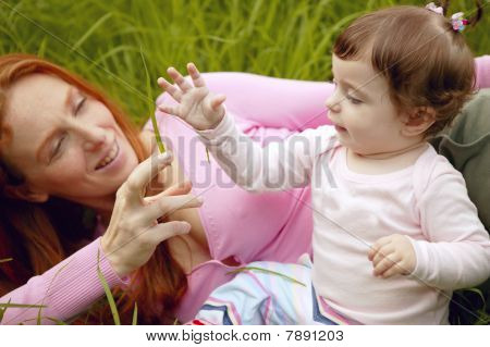 Beautiful Mother And Baby Little Girl Outdoor
