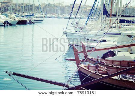 Boats In Alghero Harbor In Vintage Tone