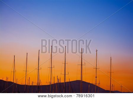 Boat Masts Silhouette Under A Colorful Sunset