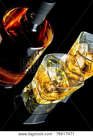Top Of View Of Whiskey With Ice In Glasses On Black Background