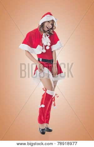 Attractive Christmas lady of Asian woman, full length portrait.