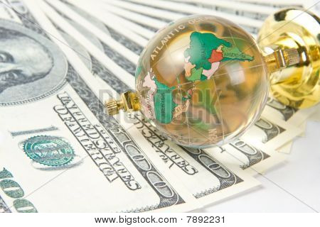 Glass Globe And Dollars