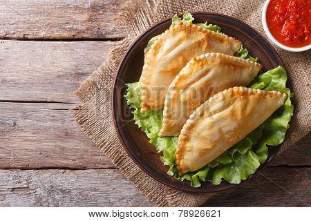 Traditional Empanadas And Sauce Closeup. Horizontal Top View