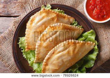 Empanadas And Sauce Closeup. Horizontal Top View, Rustic