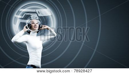 Young woman in white wearing headphones. High-tech concept