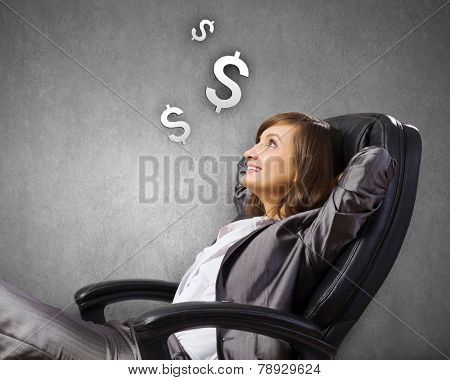 Young confident businesswoman sitting in chair with legs up