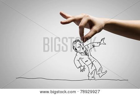 Close up of human hand catching running away businessman