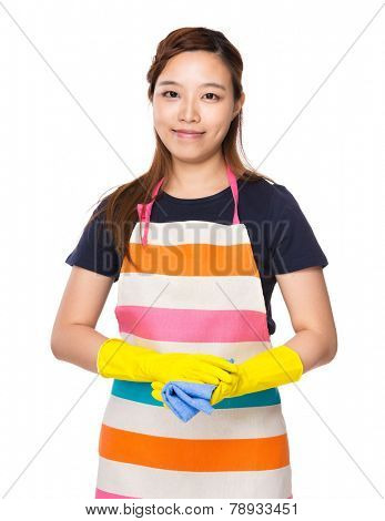 Housewife wear with plastic gloves and rag
