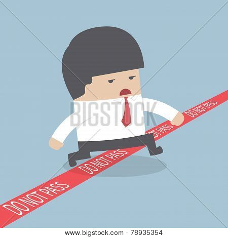 Businessman Walking Across A Red Line With Words Do Not Pass