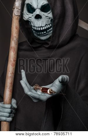 The concept: drugs kill. Grim reaper holding syringe with drugs