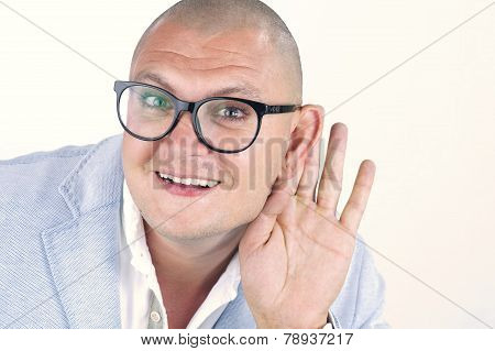 Man listening with hand behind his ear isolated on white