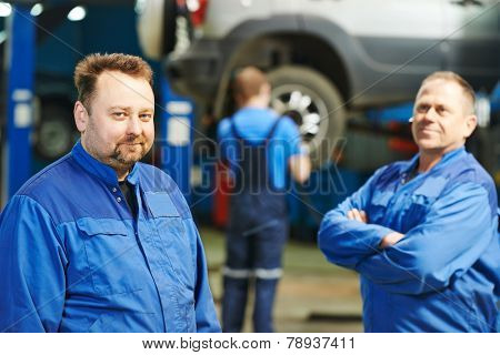 adult car mechanic portrait at automobile car repair service station