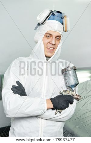 automobile repairman painter portrait in painting chamber and protective workwear