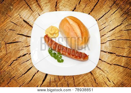 Grilled Sausage - Bratwurst with mustard, bread and parsley