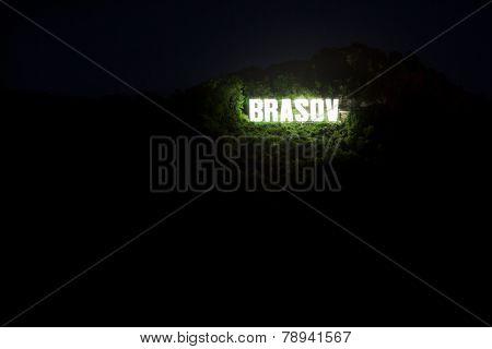 Brasov City Sign On Top Of Tampa Mountain Illuminated At Night