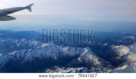 Snow-covered Mountain Peaks With Altitude Aircraft.