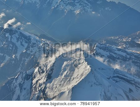 Snow-covered Mountain Peaks.