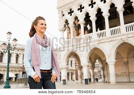 Happy Young Woman Near Doges Palace In Venice, Italy