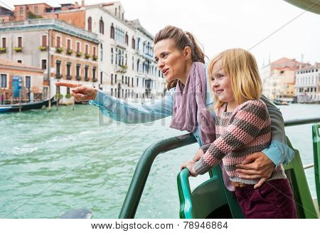 Baby Girl And Mother Poiting While Travel By Vaporetto In Venice