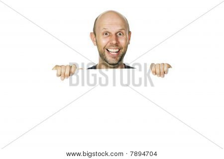 Portrait Of A Happy Funny Man Peeking Over A Wall Or White Sign. Isolated Over White.