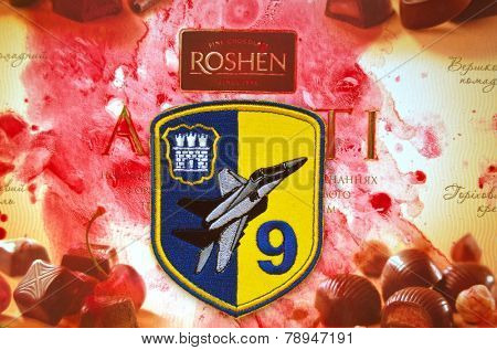 Illustrative editorial.Chevron of Ukrainian air force. 9 Aviation brigade.With logo Roshen Inc. Trademark Roshen is property of ukrainian president Poroshenko.At December 20,2014 in Kiev, Ukraine