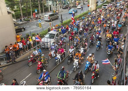 BANGKOK, THAILAND - DEC 5, 2014: Thai football fans celebrate after winning AFF Suzuki Cup 2014. Thailand ended their 12-year drought, goals gave them a dramatic 4-3 aggregate victory over Malaysia.
