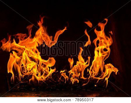 fire in a oven, two flames on the black background