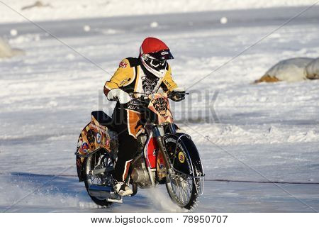 NOVOSIBIRSK, RUSSIA - DECEMBER 20, 2014: Unidentified biker during the semi-final individual rides of Russian Ice Speedway Championship.