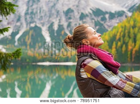 Portrait Of Relaxed Young Woman On Lake Braies In South Tyrol, I