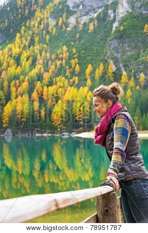 Young Woman With On Lake Braies In South Tyrol, Italy Looking In