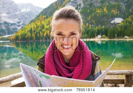Portrait Of Happy Young Woman With Map On Lake Braies In South T