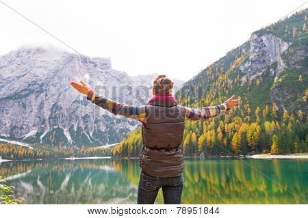 Young Woman On Lake Braies In South Tyrol, Italy Rejoicing. Rear